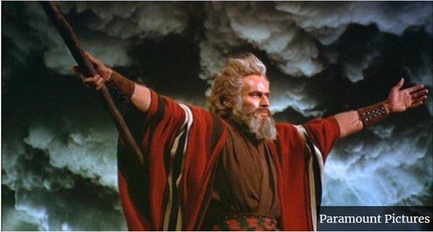 Actor Charlton Heston as Moses