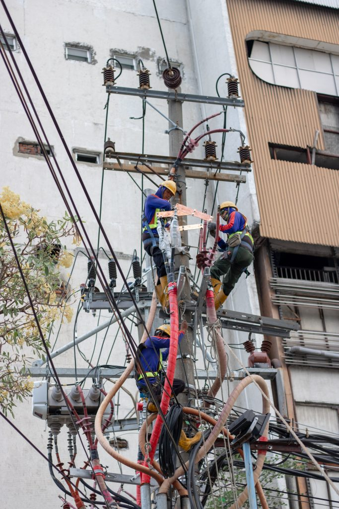 People working on complex cabling.