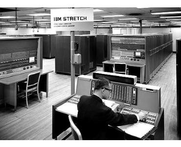 Man working at an IBM Stretch Supercomputer.