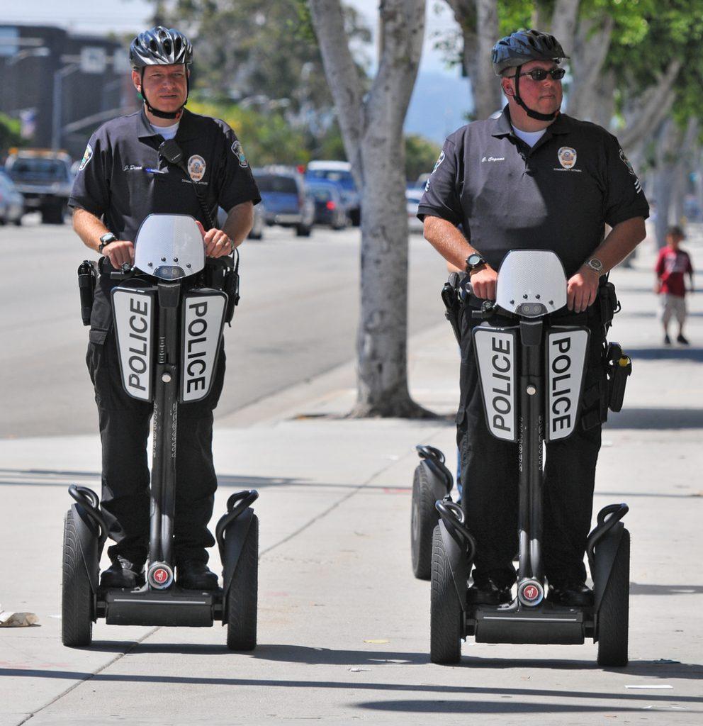 Police riding Segways.